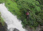 Waterfall rappelling flying Fox