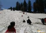Sliding in Snow Manali Adventure Camp Explorers Pune Mumbai
